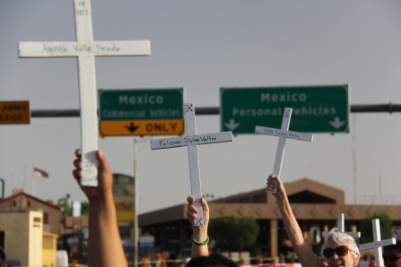 Vigil in Douglas, AZ. No Mas Muertes. No more deaths. Each of the crosses represents an individual who attempted crossing and passed away in the desert . We held up and laid on the curb over 400 crosses.
