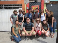 Group photo outside of the Tochan Migrant Shelter.
