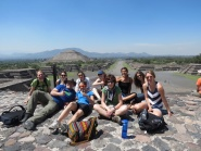 Group photo with the Pyramid of the Sun in the background.